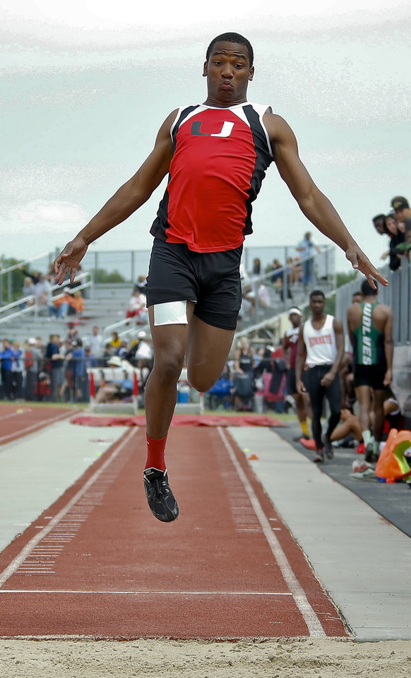 Photo - Tulsa Union's Ayo Ologala competes in the Class 6A boys long during the Class 6A and 5A state championship track meet at Yukon High School on Saturday, May 17, 2014 in Yukon, Okla.   Photo by Chris Landsberger, The Oklahoman