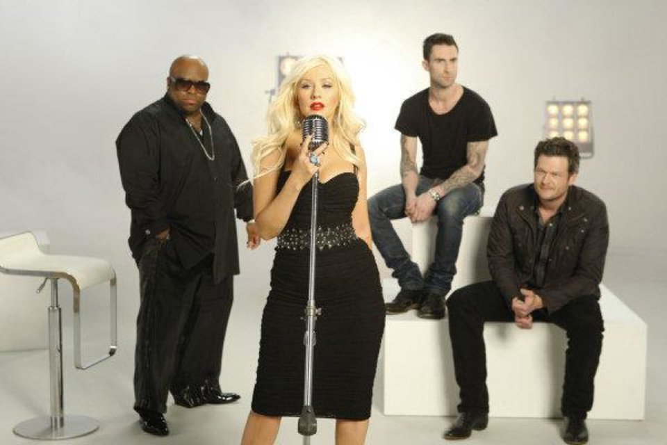 Photo - Music stars, from left, Cee Lo Green, Christina Aguilera, Adam Levine and Oklahoman Blake Shelton are the celebrity coaches on the new TV singing contest
