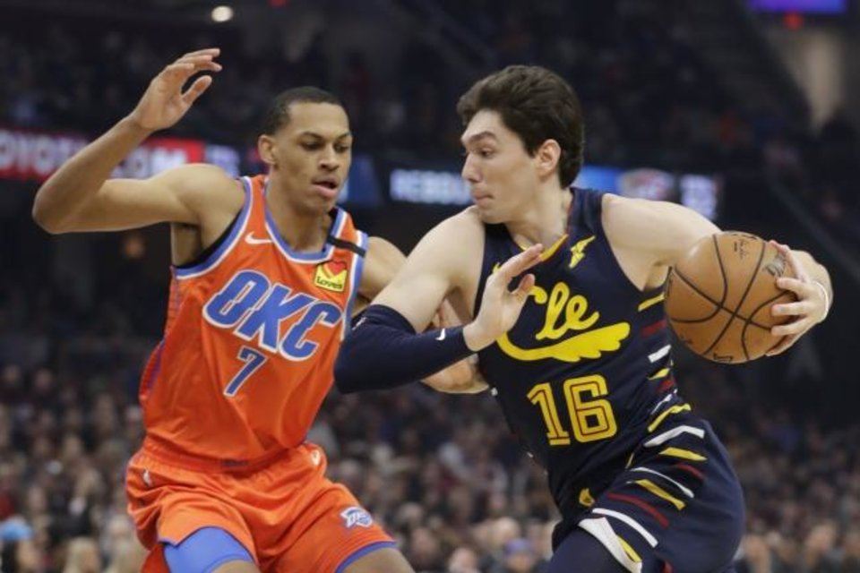 Photo -  Thunder rookie Darius Bazley (7) defends Cavaliers forward Cedi Osman during OKC's 121-106 win Saturday in Cleveland. [AP Photo/Tony Dejak]