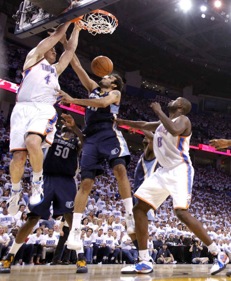 Photo - Oklahoma City's Nick Collison (4) dunks over Hamed Haddadi (15) of Memphis during game five of the Western Conference semifinals between the Memphis Grizzlies and the Oklahoma City Thunder in the NBA basketball playoffs at Oklahoma City Arena in Oklahoma City, Wednesday, May 11, 2011. Photo by Sarah Phipps, The Oklahoman