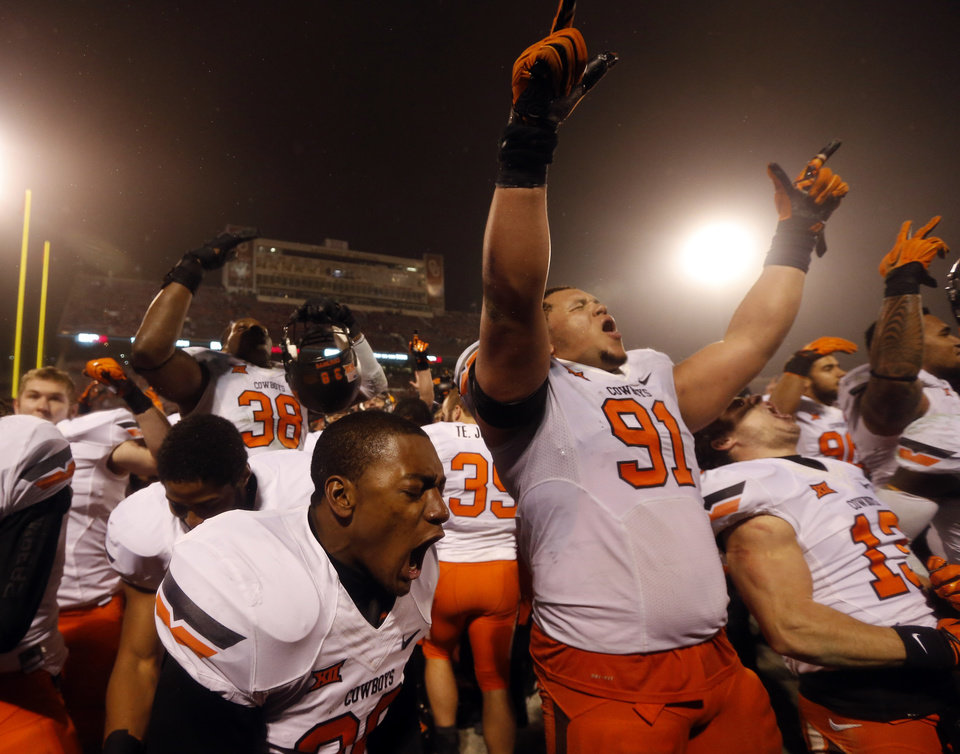 Photo - Oklahoma State's James Castleman (91) celebrates following the Bedlam college football game between the University of Oklahoma Sooners (OU) and the Oklahoma State Cowboys (OSU) at Gaylord Family-Oklahoma Memorial Stadium in Norman, Okla., Saturday, Dec. 6, 2014. Photo by Sarah Phipps, The Oklahoman