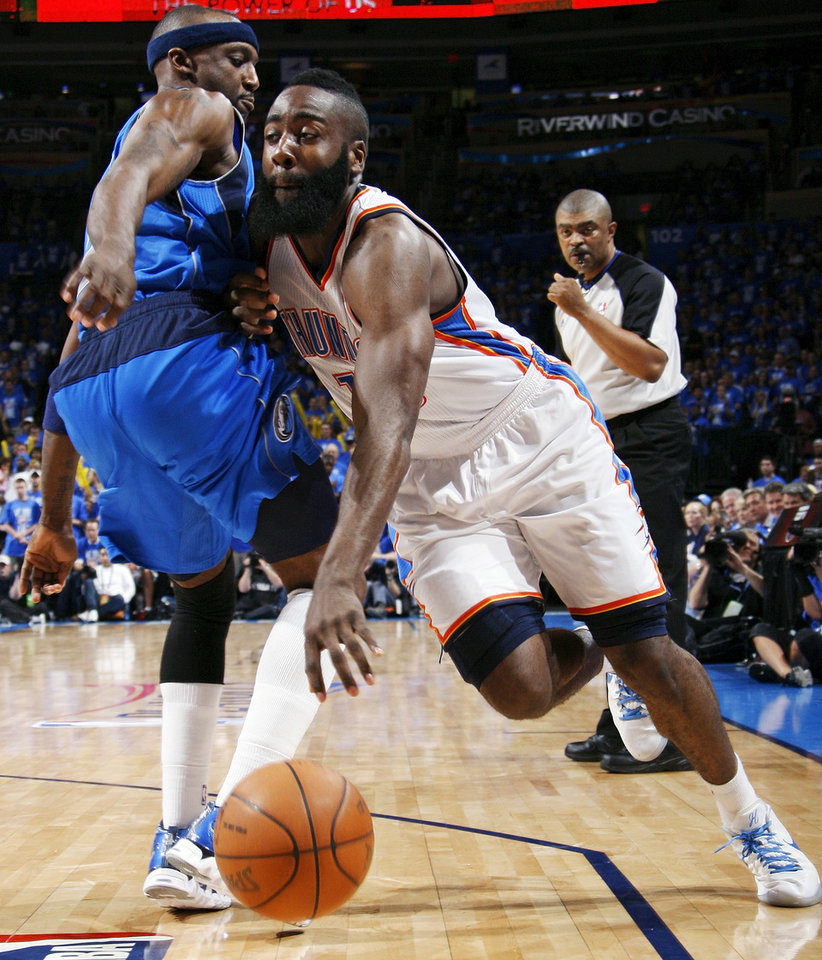 Oklahoma City\'s James Harden (13) drives the ball on Dallas\' Jason Terry (31) during game one of the first round in the NBA playoffs between the Oklahoma City Thunder and the Dallas Mavericks at Chesapeake Energy Arena in Oklahoma City, Saturday, April 28, 2012. Oklahoma City won, 99-98. Photo by Nate Billings, The Oklahoman