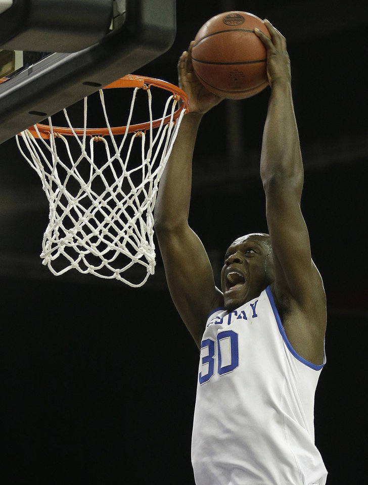 Photo - FILe - In this March 14, 2014 file photo, Kentucky forward Julius Randle (30) dunks the ball against LSU during the second half of an NCAA college basketball game in the quarterfinal round of the Southeastern Conference men's tournament, in Atlanta. Randle will leave after one season to enter the NBA draft, where he is expected to be among the top five selections. With five days left before the deadline for underclassmen to declare, the 6-foot-9 Dallas native announced, Tuesday, April 22, 2014, the decision many expected even before he arrived as part of Kentucky's best recruiting class ever. (AP Photo/Steve Helber, File)