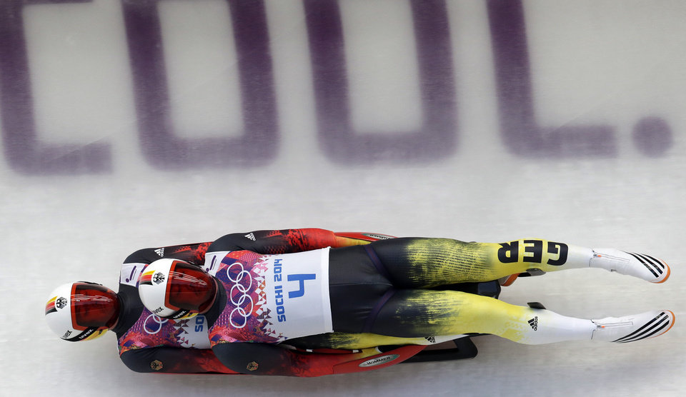 Photo - The doubles team of Tobias Wendl and Tobias Arlt from Germany speeds down the track in their first run during the men's doubles luge at the 2014 Winter Olympics, Wednesday, Feb. 12, 2014, in Krasnaya Polyana, Russia. (AP Photo/Michael Sohn)