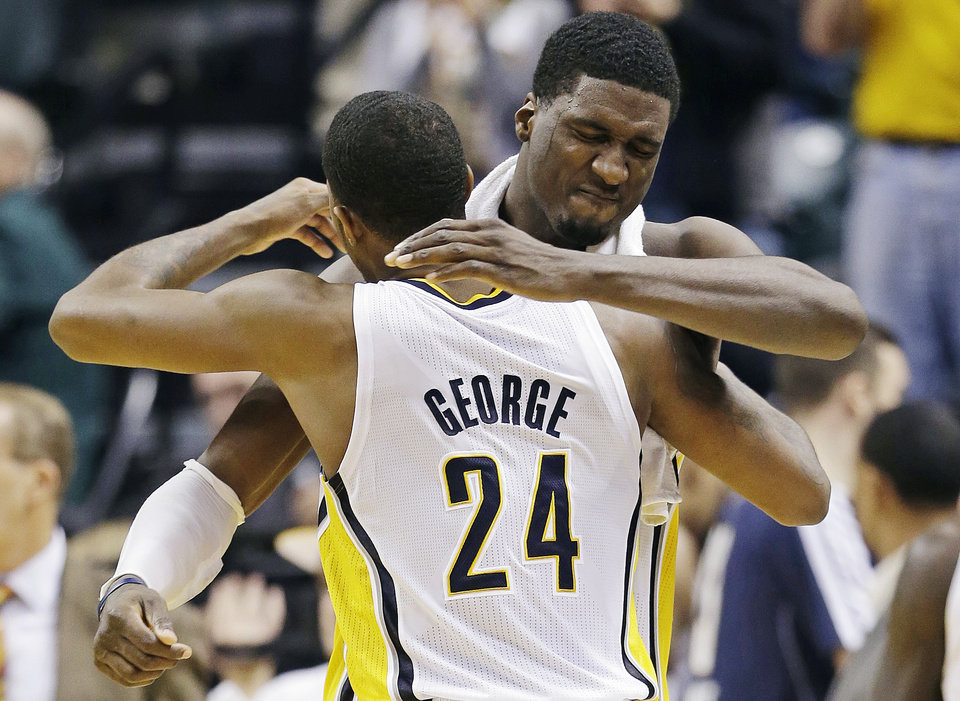 Photo -   Indiana Pacers' Paul George (24) embraces Roy Hibbert after defeating the New Orleans Hornets 115-107 in overtime of an NBA basketball game, Wednesday, Nov. 21, 2012, in Indianapolis. (AP Photo/Darron Cummings)