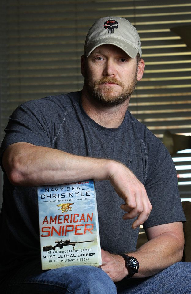 "Photo - FILE - In this April 6, 2012 file photo, Chris Kyle, a former Navy SEAL and author of the book ""American Sniper,"" poses in Midlothian, Texas. Kyle and his friend Chad Littlefield were fatally shot at a shooting range southwest of Fort Worth, Texas, on Saturday, Feb. 2, 2013. Former Marine Eddie Ray Routh, who came with them to the range, has been arrested for the murders. (AP Photo/The Fort Worth Star-Telegram, Paul Moseley, File)"
