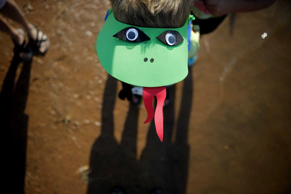 Five-year-old Dane Janowski wears a visor in support of the team Nessie during Edmond's Cardboard Boat Regatta at Arcadia Lake in Edmond, Okla., Saturday, August 27, 2011. Photo by Bryan Terry, The Oklahoman