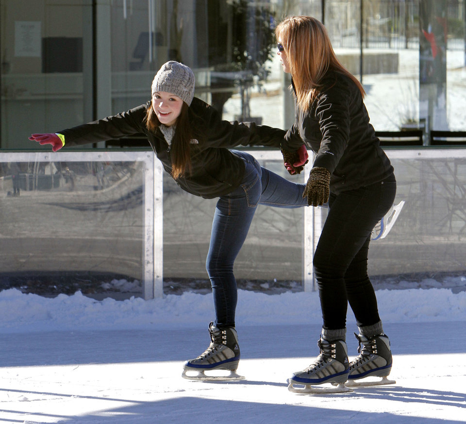 Photo - Below left: Brady Ledonne, left, and Toni Ledonne skate Saturday. Photos By Paul Hellstern,  The Oklahoman
