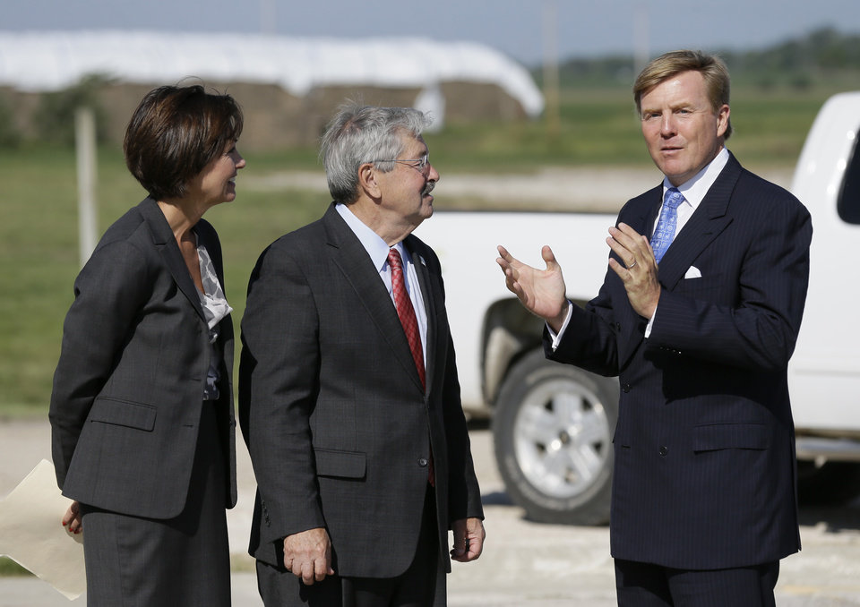 Photo - King Willem-Alexander, right, of the Netherlands is greeted by Iowa Gov. Terry Branstad, center, and Iowa Lt. Gov. Kim Reynolds, left, while arriving at the opening of one of the nation's first commercial size cellulosic ethanol plants, Wednesday, Sept. 3, 2014, in Emmetsburg, Iowa. Project Liberty is a $250 million plant that will make 25 million gallons of ethanol a year from corn cobs, stalks, leaves and other plant residue. (AP Photo/Charlie Neibergall)