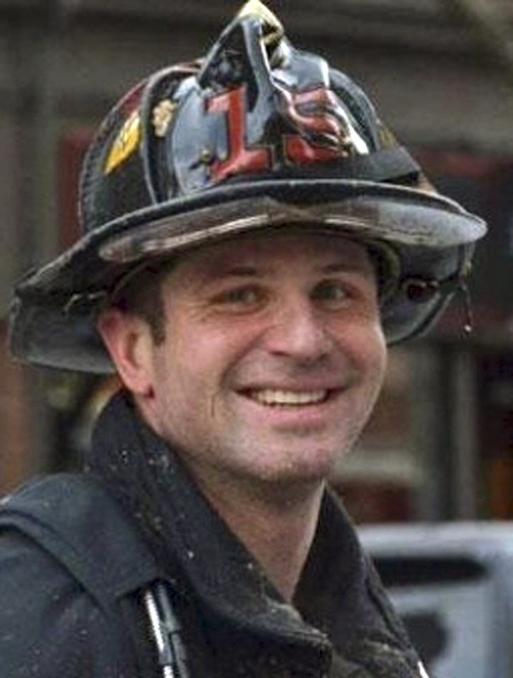 Photo - This undated photo released by the Boston Fire Department via Twitter shows firefighter Michael R. Kennedy, killed Wednesday, March 26, 2014, when trapped the basement while fighting a fire in an apartment building in Boston. Kennedy, 33, a Marine Corps combat veteran was assigned to Ladder 15, and had been a firefighter for more than six years. (AP Photo/Boston Fire Department)