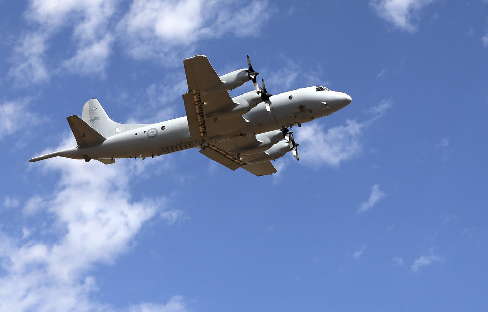 Photo - A Royal Australian Air Force AP-3C Orion takes off at RAAF Pearce Base to join the search for the missing Malaysia Airlines flight MH370 in Perth, Australia, Sunday, March 23, 2014. More planes were joining the search Sunday of a remote patch of the southern Indian Ocean in hopes of finding answers to the fate of the missing Malaysia Airlines jet, after China released a satellite image showing a large object floating in the search zone.  (AP Photo/Rob Griffith, Pool)