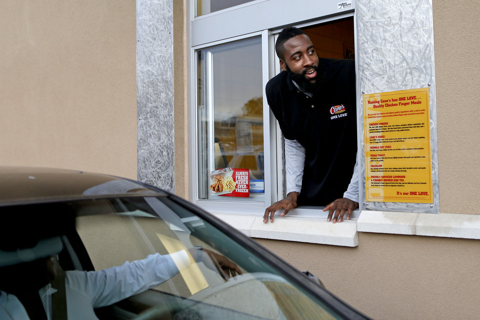 James Harden of the Oklahoma City Thunder greets a customer in the drive-thru lane of the new Raising Cane's in Edmond, Thursday, September 27, 2012. Photo by Bryan Terry, The Oklahoman