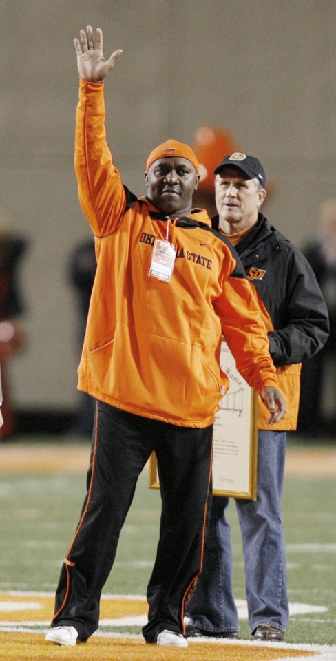 Photo - Former OSU Cowboy Thurman Thomas is introduced during a break in the first half of the college football game between the University of Oklahoma Sooners (OU) and Oklahoma State University Cowboys (OSU) at Boone Pickens Stadium on Saturday, Nov. 29, 2008, in Stillwater, Okla.  STAFF PHOTO BY CHRIS LANDSBERGER