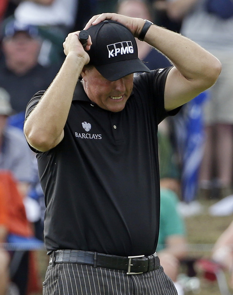 Photo - Phil Mickelson reacts after missing an eagle putt on the seventh hole during the final round of the PGA Championship golf tournament at Valhalla Golf Club on Sunday, Aug. 10, 2014, in Louisville, Ky. (AP Photo/David J. Phillip)