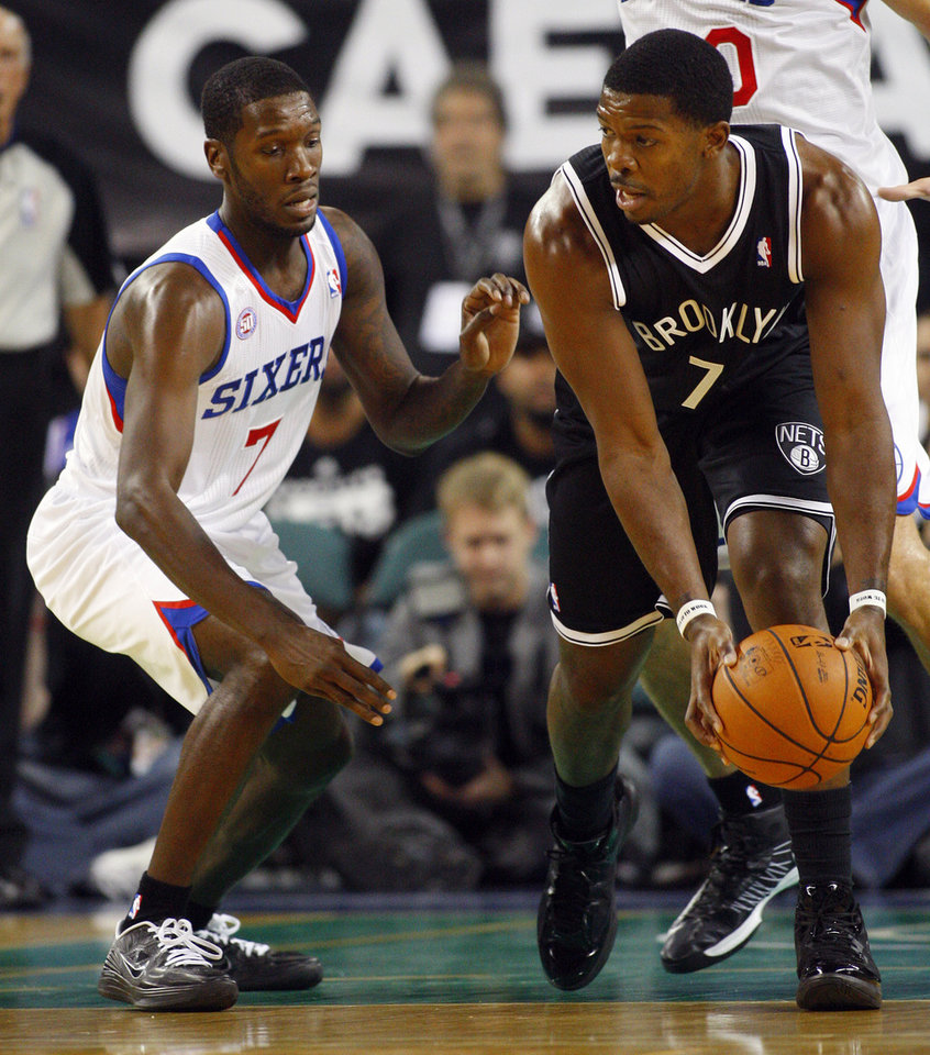 Brooklyn Nets\' Joe Johnson (7) looks to get around Philadelphia 76ers\' Royal Ivey (7) in an NBA preseason basketball game in Atlantic City , N.J., Saturday, Oct. 13, 2012. The Nets defeated the 76ers 108-105 in overtime. (AP Photo/Rich Schultz)