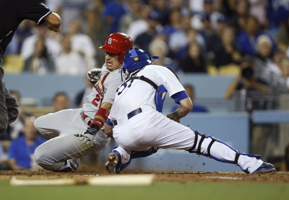 Photo - Los Angeles Dodgers catcher Drew Butera tags out St. Louis Cardinals' Jon Jay at home plate on a play that was reviewed during the seventh inning of a baseball game, Thursday, June 26, 2014, in Los Angeles. The review confirmed the original call, and Jay was out. (AP Photo/Danny Moloshok)