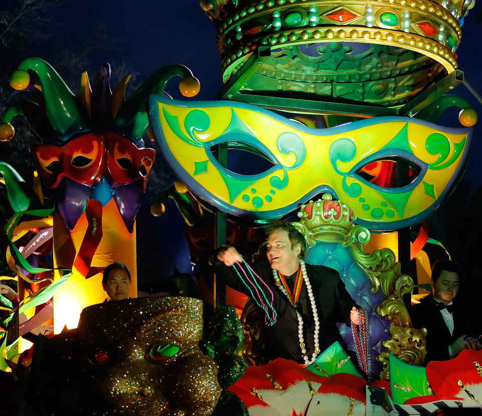 Photo - The Krewe of Orpheus rolls in uptown New Orleans, led by celebrity monarch Quentin Tarantino reigning over the superkrewe's 32-float parade on Lundi Gras, Monday, March 3, 2014. The float theme for 2014 is