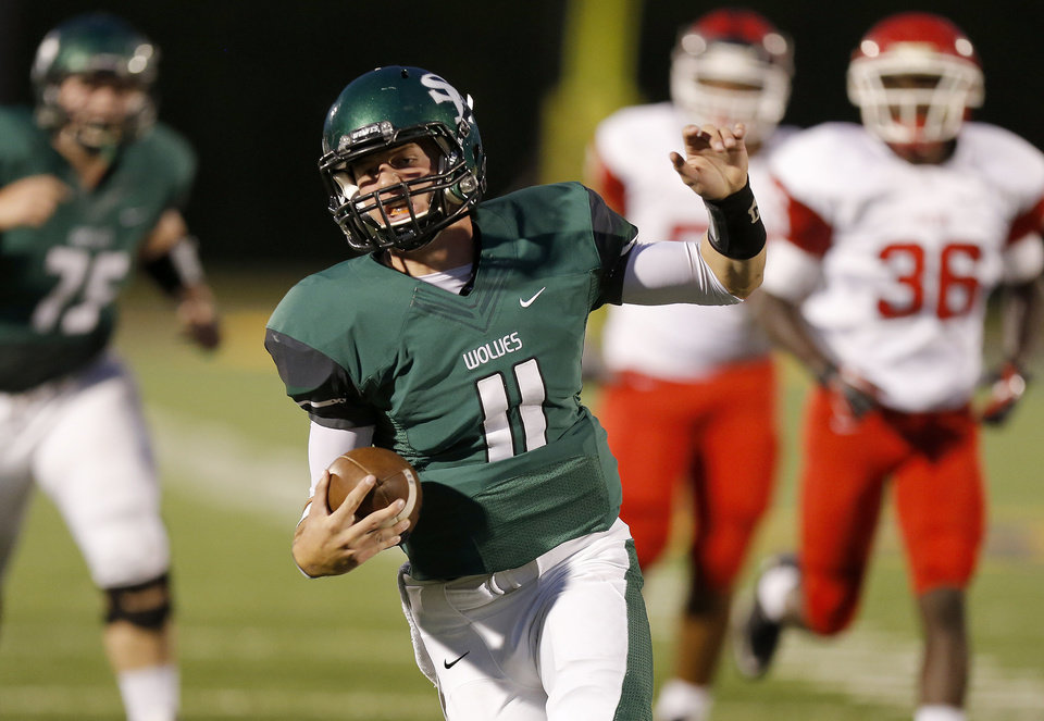 Photo - Edmond Santa Fe's Justice Hansen runs for a touchdown against Lawton during their high school football game at Wantland Stadium in Edmond, Okla., Thursday, October 11, 2012. Photo by Bryan Terry, The Oklahoman