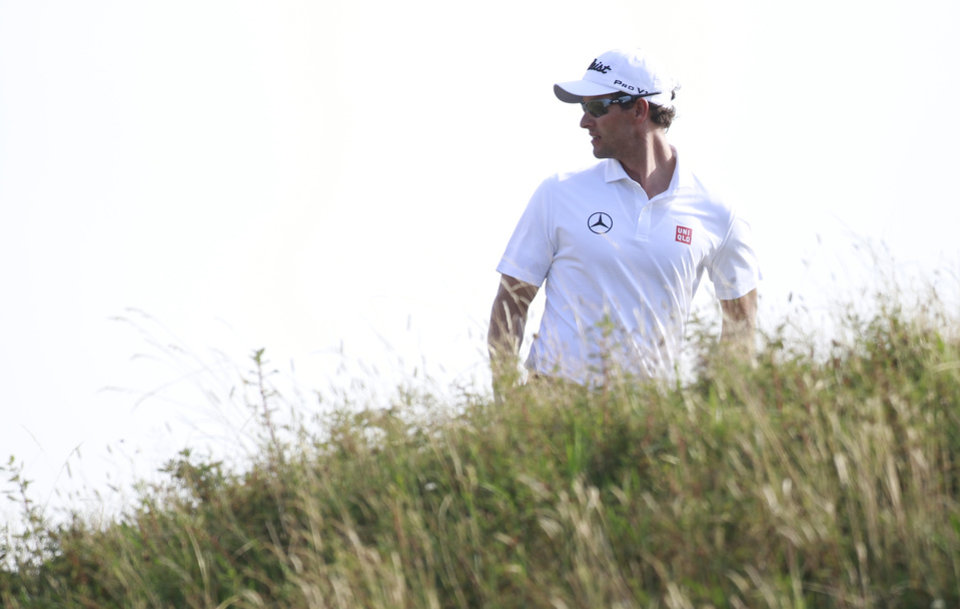 Photo - Adam Scott of Australia walks up to the 14th tee box during the first day of the British Open Golf championship at the Royal Liverpool golf club, Hoylake, England, Thursday July 17, 2014. (AP Photo/Peter Morrison)