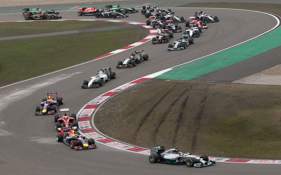 Photo - Mercedes driver Lewis Hamilton of Britain leads the field into turn three at the start of the Chinese Formula One Grand Prix at Shanghai International Circuit in Shanghai, Sunday, April 20, 2014. (AP Photo/Eugene Hoshiko)
