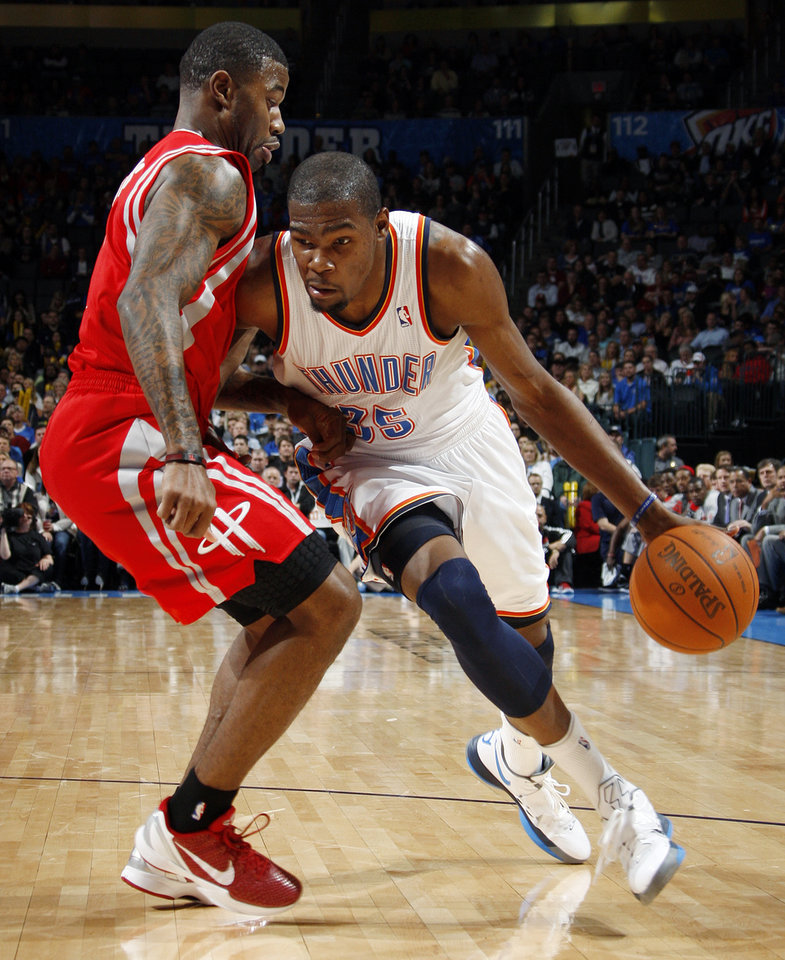 Oklahoma City's Kevin Durant (35) dribbles around Terrence Williams (1) of Houston in the first quarter during the NBA basketball game between the Oklahoma City Thunder and the Houston Rockets at Chesapeake Energy Arena in Oklahoma City, Friday, Jan. 6, 2012. Photo by Nate Billings, The Oklahoman