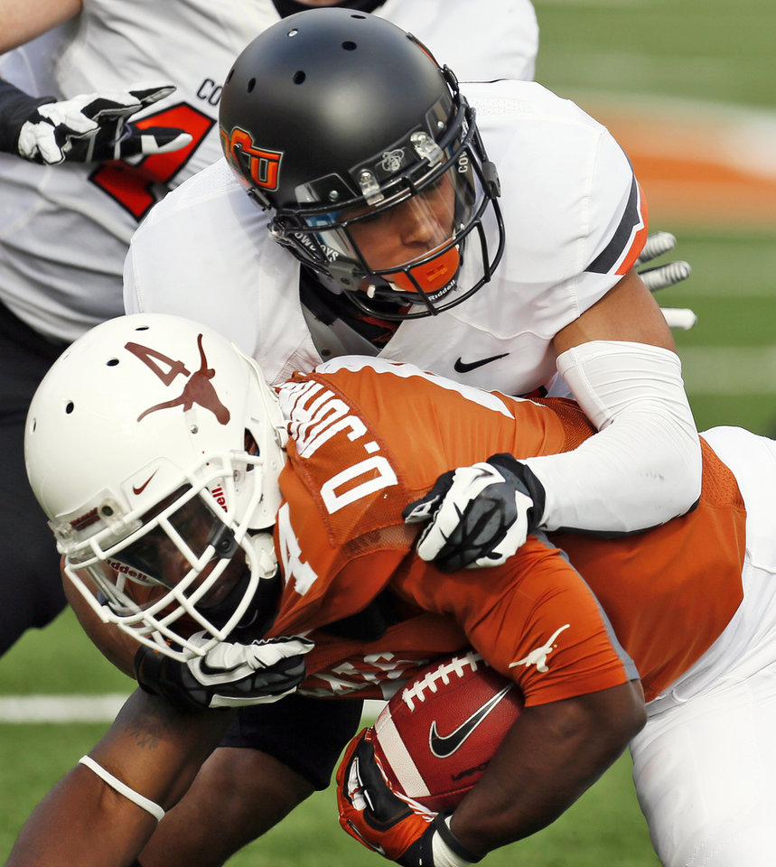 Oklahoma State\'s Tyler Patmon (26) tackles UT\'s Daje Johnson (4) during a college football game between the Oklahoma State University Cowboys (OSU) and the University of Texas Longhorns (UT) at Darrell K Royal - Texas Memorial Stadium in Austin, Texas, Saturday, Nov. 16, 2013. Photo by Nate Billings, The Oklahoman