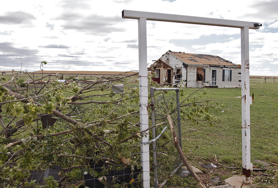 Photo - A small farm house still stands after being hit by Tuesday's tornado west of El Reno, Wednesday, May 25, 2011. Photo by Chris Landsberger, The Oklahoman