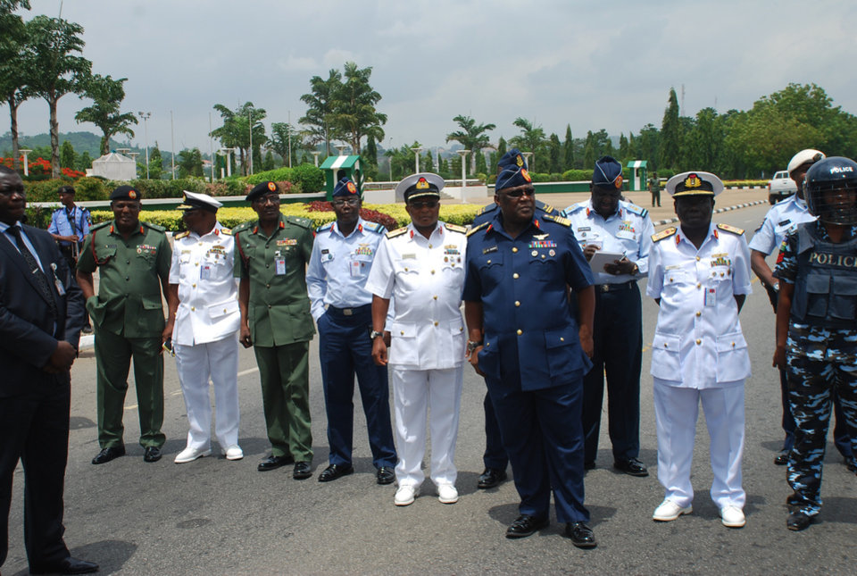 Photo - Nigeria's chief of defense staff Air Marshal Alex S. Badeh, front, and other army chiefs wait to address the Nigerians Against Terrorism group during a demonstration calling on the government to rescue the kidnapped girls of the government secondary school in Chibok, in Abuja, Nigeria, Monday, May 26, 2014. Scores of protesters chanting
