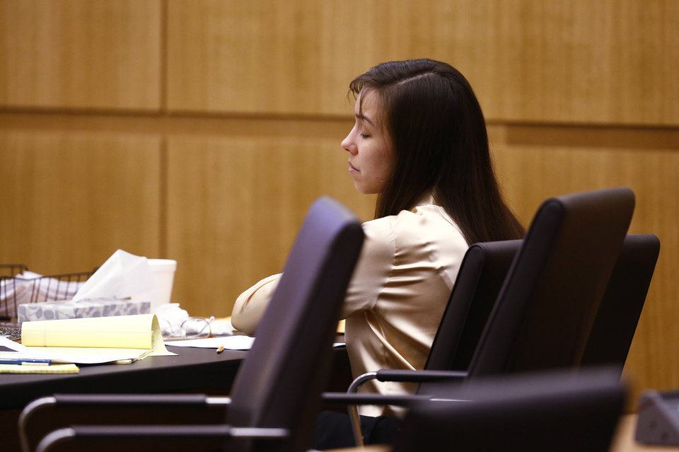 Photo - Jodi Arias reacts as the jury begins deliberation whether there was an aggravating factor in the murder of Travis Alexander on Wednesday, May 15, 2013, during the sentencing phase of her trial at Maricopa County Superior Court in Phoenix. If the jury finds aggravating factors in her crime, Arias could be sentenced to death.   (AP Photo/The Arizona Republic, Rob Schumacher, Pool)