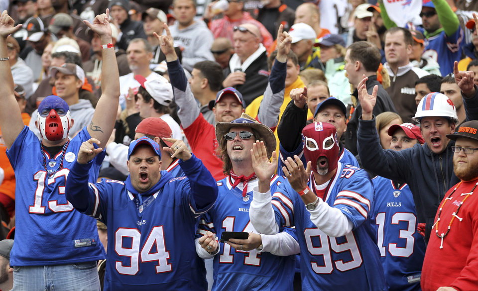 Photo -   Buffalo Bills fans cheer after a Bills' touchdown in the fourth quarter of an NFL football game against the Cleveland Browns, Sunday, Sept. 23, 2012, in Cleveland. (AP Photo/Tony Dejak)