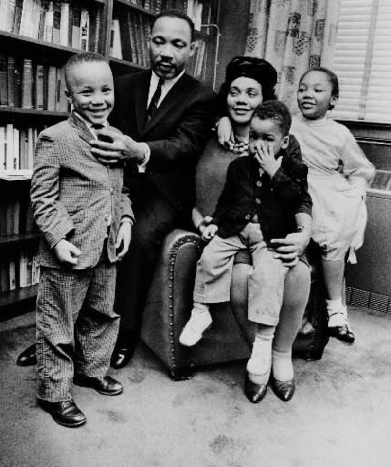 Photo - Dr.  Martin  Luther  King  Jr. and his wife, Coretta Scott  King, sit with three of their four children in their Atlanta, Ga, home, in this March 17, 1963 file photo. From left are:  Martin  Luther  King III, 5, Dexter Scott, 2, and Yolanda Denise, 7.  (AP Photo)
