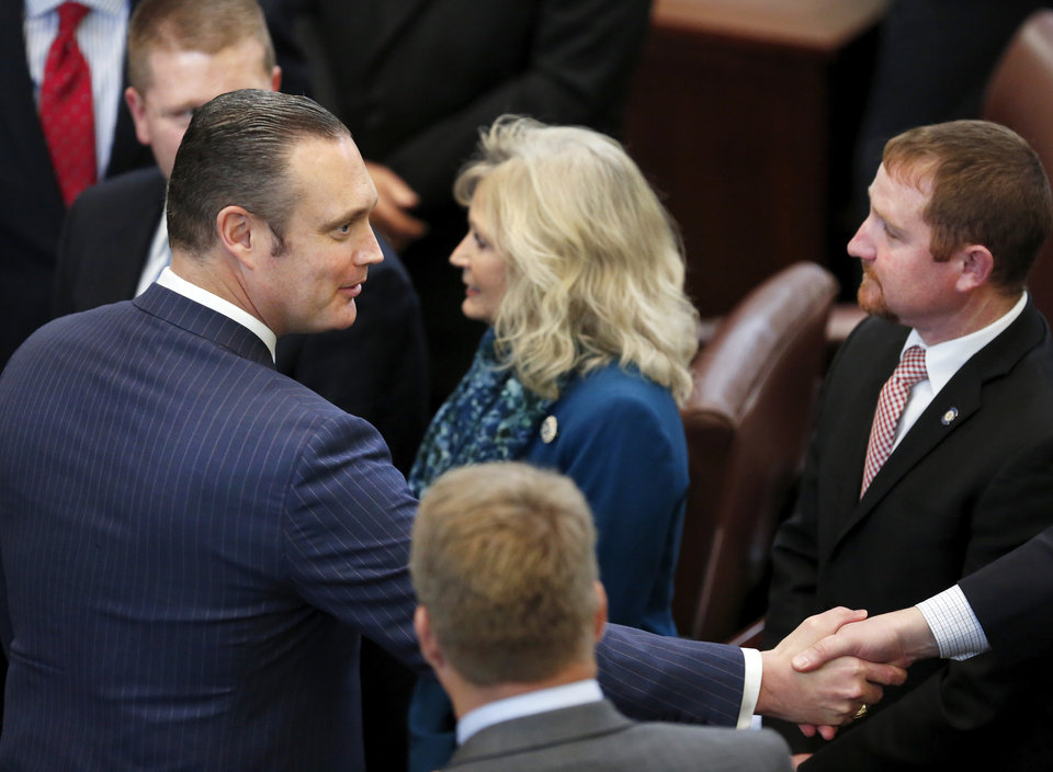 Photo -  Oklahoma House Speaker Charles McCall, R-Atoka, left, accepts congratulations from lawmakers after being elected to the top post in the House by his legislative colleagues. State representatives meet for an organizational day in the House chamber on Tuesday, Jan. 3, 2017. Initial discussion focused on the resignation/non-resignation of Rep. Dan Kirby, Tulsa, who has been accused of sexual harassment with a former staff member. [Photo by Jim Beckel, The Oklahoman]