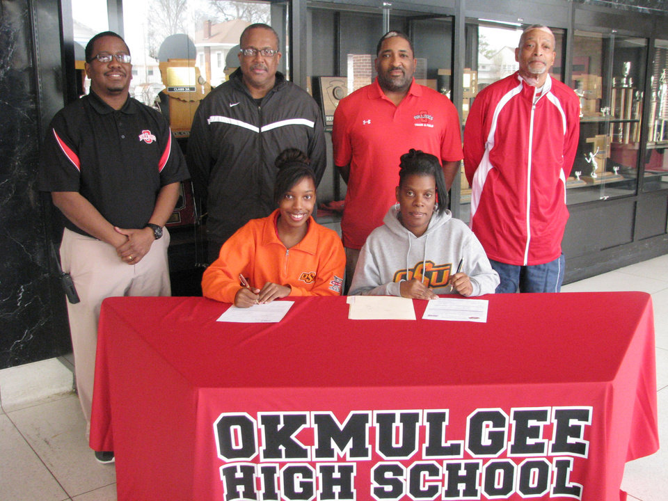 Photo - Okmulgee High School senior Brittany Stallings, front row left, signed a National Letter of Intent with Oklahoma State University on Wednesday afternoon. Stallings will participate in track and field for the Stillwater college. Seated next to Stallings is her mother, Marva Stallings. Also present for the signing were, back row, L to R: Okmulgee Athletic Director Kevin Gordon, Okmulgee girls track coach Gary Robbins, Okmulgee assistant track coach Kevin Rucker, and Okmulgee head track coach Dwight Pankey.
