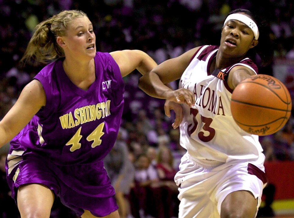 NCAA WOMEN'S BASKETBALL TOURNAMENT: OU's Rosalind Ross tries to pass the ball around Cheryl Sorenson of Washington during OU's loss in the sweet sixteen in Spokane.  Staff photo by Bryan Terry