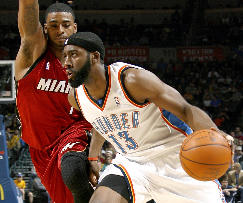 Photo - Oklahoma City's James Harden moves past Miami's Dorell Wright during the NBA basketball game between the Oklahoma City Thunder and the Miami Heat at the Ford Center in Oklahoma City, Saturday, January 16, 2010. Photo by Bryan Terry, The Oklahoman