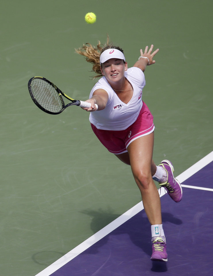 Photo - Coco Vandeweghe returns to Serena Williams at the Sony Open tennis tournament, Monday, March 24, 2014, in Key Biscayne, Fla. (AP Photo/Lynne Sladky)
