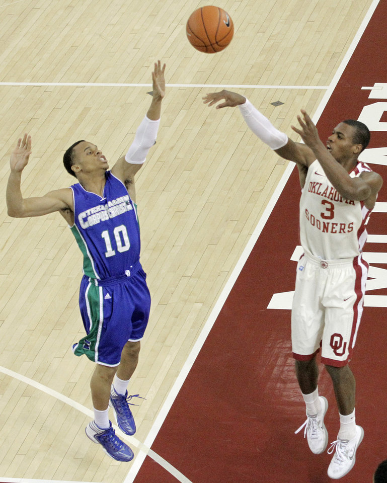 Photo - OU: Oklahoma's Buddy Hield (3) shoots over Texas A&M's Johnathan Jordan (10) during a college basketball game between the University of Oklahoma and Texas A&M Corpus Christi at McCasland Field House in Norman, Okla., Monday, Dec. 31, 2012.  Photo by Garett Fisbeck, For The Oklahoman