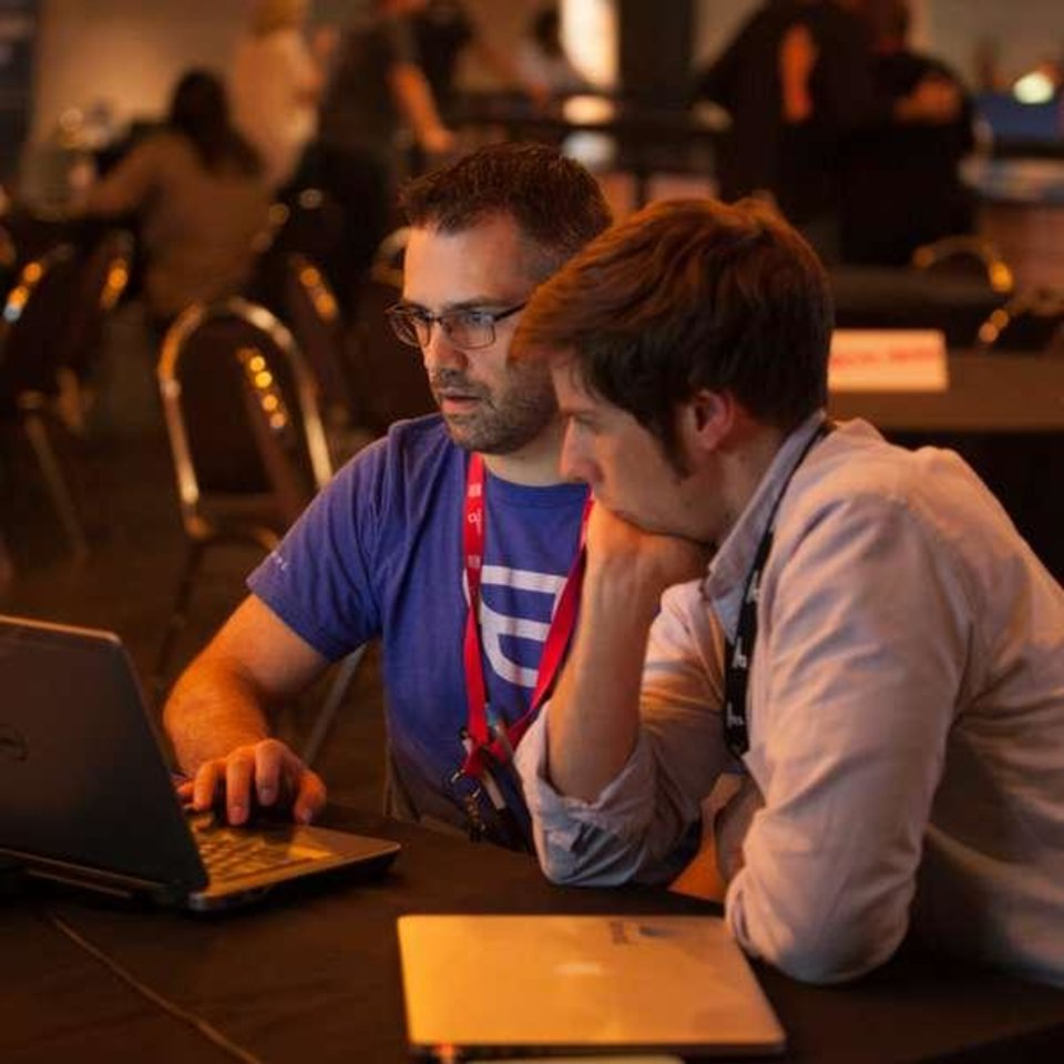 Photo - Adam Kutner and David Christopher connect at Confluence Conference in Oklahoma City last year. Photo provided by Confluence.