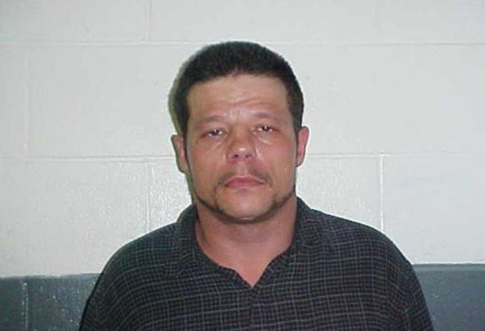 Photo -  This June 8, 2010, photo provided by the Kay County Detention Center shows Michael Vance. Authorities are searching for Vance, who is suspected in a double slaying and accused of shooting and wounding multiple police officers near Oklahoma City on Sunday. [Kay County Detention Center via AP]