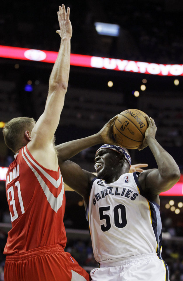 Memphis Grizzlies\' Zach Randolph (50) tries to shoot over Houston Rockets\' Cole Aldrich (31) during the first half of an NBA basketball game in Memphis, Tenn., Friday, Nov. 9, 2012. (AP Photo/Daniel Johnston)
