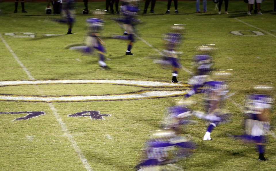 The Chickasha kick-off team team runs by Kody Turner's number painted on the 50-yard line during the football game between Chickasha and Capitol Hill at Chickasha High School, Friday, Oct. 1, 2010. It was the first home game since the death of player Kody Turner. Photo by Sarah Phipps, The Oklahoman