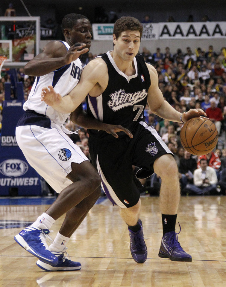 Photo - Dallas Mavericks point guard Darren Collison (4) defends against Sacramento Kings' Jimmer Fredette (7) in the first half of an NBA basketball game Monday, Dec. 10, 2012, in Dallas. (AP Photo/Tony Gutierrez)