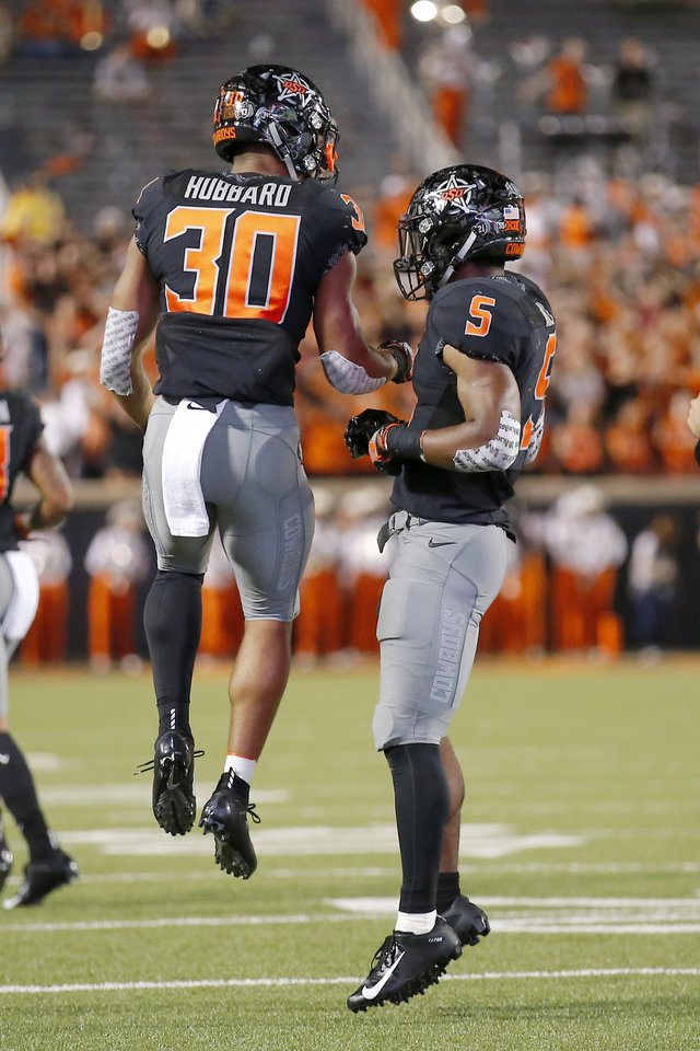 Photo - Oklahoma State's Justice Hill (5) and Chuba Hubbard (30) celebrate a Hill touchdown in the second quarter during a college football game between Oklahoma State (OSU) and South Alabama at Boone Pickens Stadium in Stillwater, Okla., Saturday, Sept. 8, 2018. Photo by Sarah Phipps, The Oklahoman