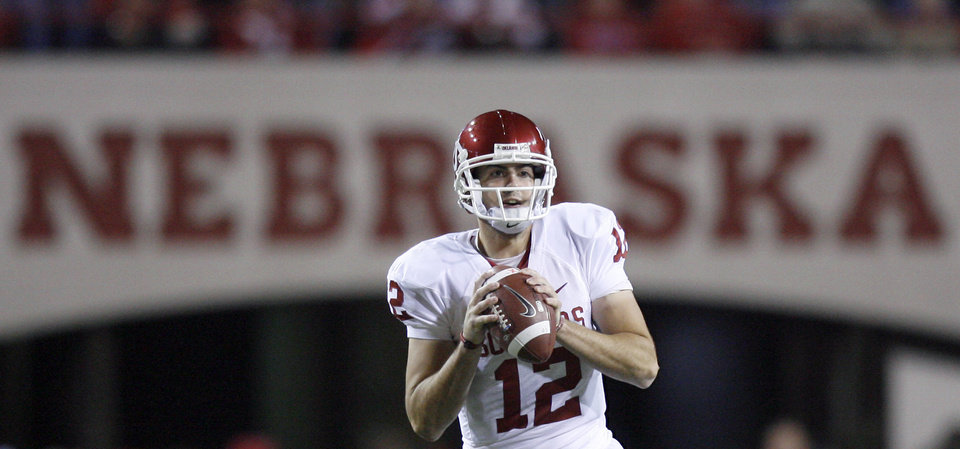 Photo - OU's Landry Jones (12) stand in the pocket during the second half of the college football game between the University of Oklahoma Sooners (OU) and the University of Nebraska Cornhuskers (NU) on Saturday, Nov. 7, 2009, in Lincoln, Neb. Photo by Sarah Phipps, The Oklahoman