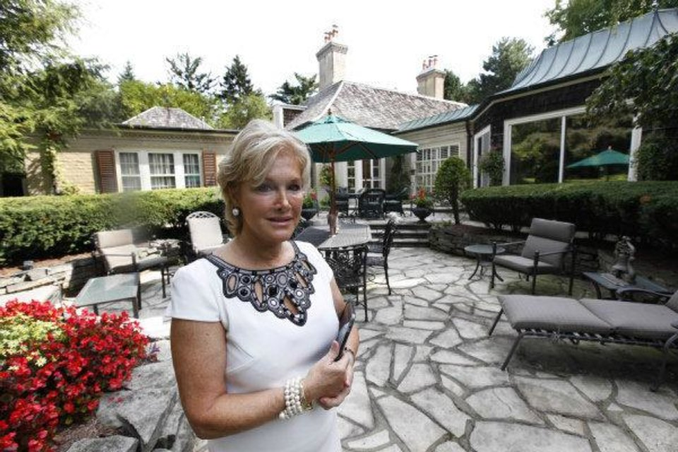 Photo - In this Aug. 23, 2011 photo, real estate agent Ronni Keating waits for a client to view a home in Bloomfield Hills, Mich. Think of this housing market as bipolar. In the luxury sector, the recession is a memory and sales and prices are rising. But everywhere else, the market is moving sideways or getting worse. (AP Photo/Paul Sancya) ORG XMIT: MIPS204