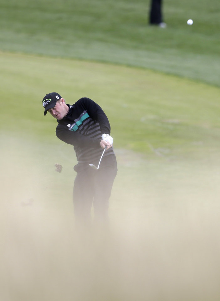 Photo - Jamie Donaldson from Wales plays a shot during the golf Czech Masters European Tour Event in Vysoky Ujezd, Czech Republic, Sunday, Aug. 24, 2014. (AP Photo/Petr David Josek)