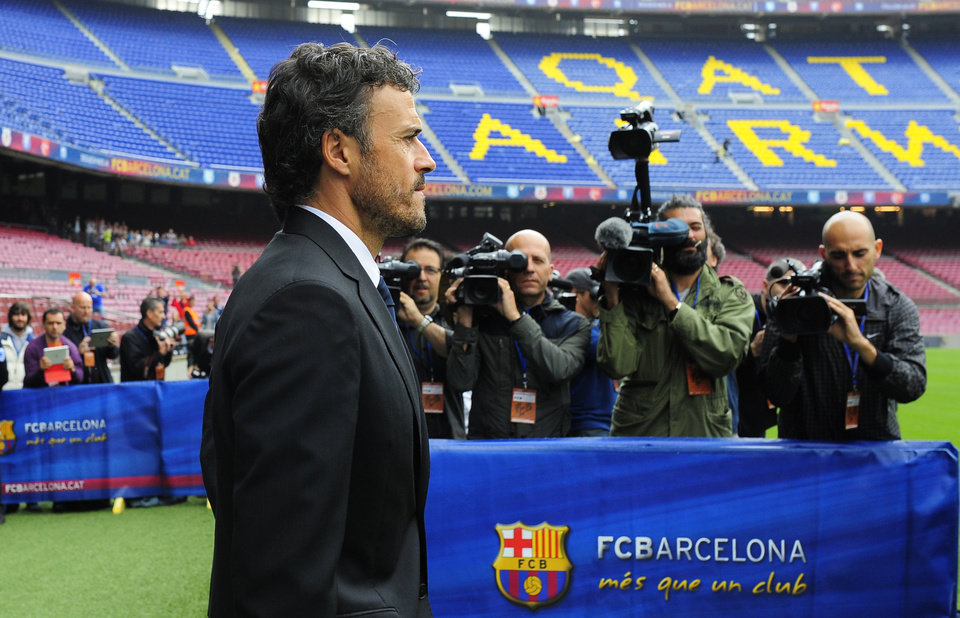 Photo - Luis Enrique arrives for his official presentation as new coach of FC Barcelona at the Camp Nou stadium in Barcelona, Spain, Wednesday, May 21, 2014. Former Barcelona player Luis Enrique signed a two-year contract to become coach on Wednesday, a hire the club hopes will resemble the success stories of Johan Cruyff and Pep Guardiola. (AP Photo/Manu Fernandez)
