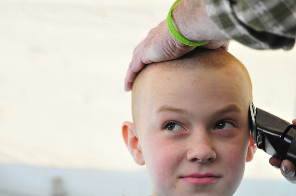 Wiley Kerr, 12, gets his shaved head during the St. Baldrick\'s charity event at VZD\'s Restaurant and Club in Oklahoma City, Okla. Sunday, March 23, 2013. Photo by Nick Oxford, for The Oklahoman