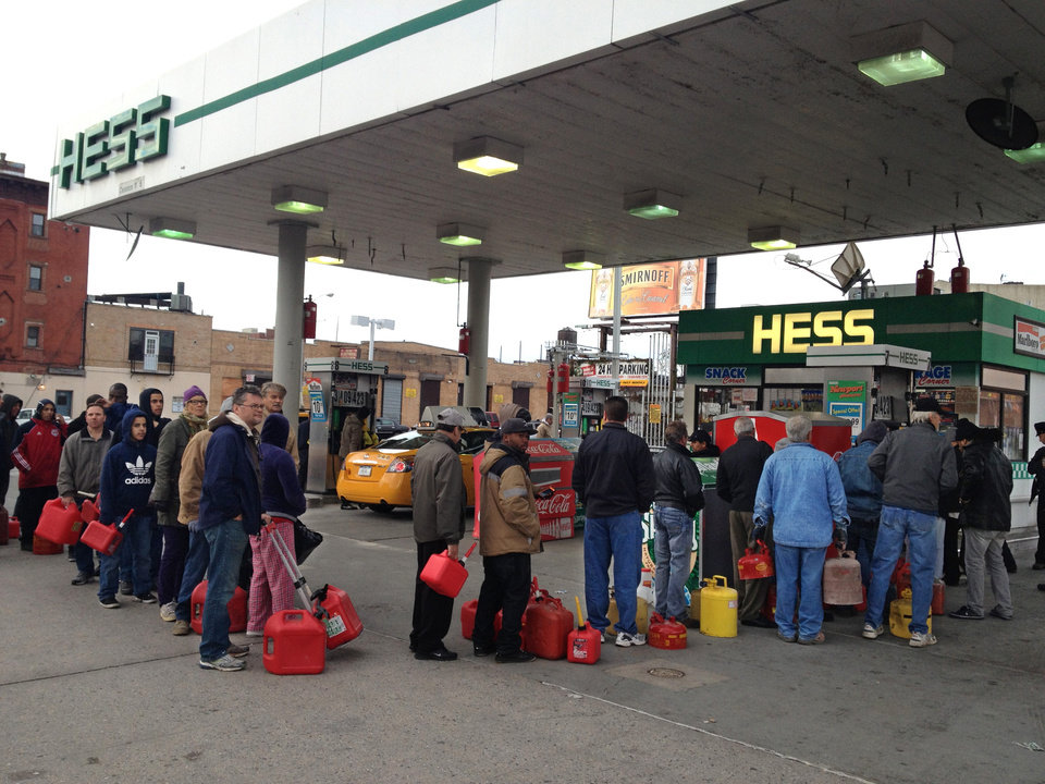 Shortly before the gas ran out, customers wait in line at a Hess station where the line of cars snaked 10 blocks, and at least 60 people waited to fill red gas cans for their generators, in the Gowanus section of Brooklyn, New York Friday morning, Oct 2, 2012. Courier Winston Alfred said he had been there in his van since 4:20 am, and was second in line, when he was turned away four hours later. (AP Photo/David Caruso)