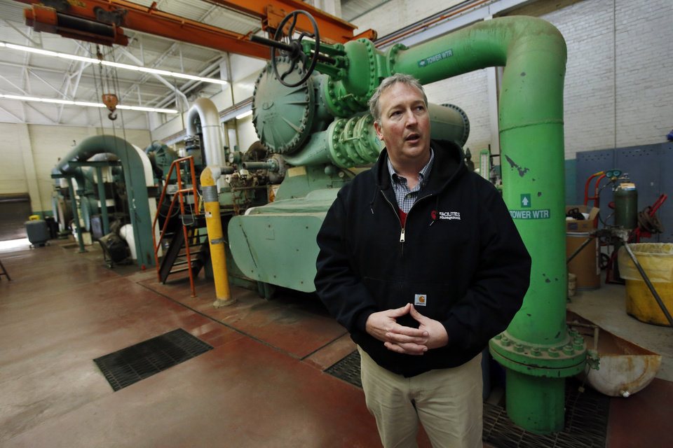 University of Oklahoma facilities manager Brian Ellis shows a 1950 chiller in the campus' old power plant as he discusses energy saving enhancements to the Norman campus on Tuesday, Nov. 27, 2012 in Norman, Okla.  Photo by Steve Sisney